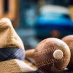 Travel to Cuba related items, hat and maracas with old car background
